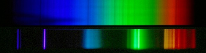 Top: The nearly continuous spectrum of the Sun.  Bottom: The bright line spectrum of a compact florescent light.  Credit: John P. Beale